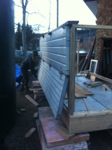 salvaged garage doors make an easy insulated wall